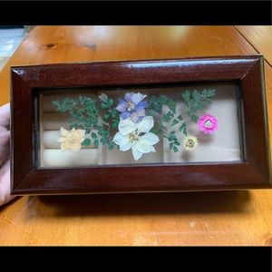 Antique musical jewelry box with pressed flowers